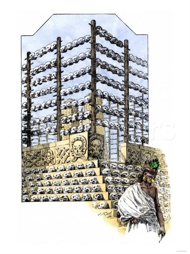 Ricostruzione di zompantli. La base di pietra e le file di pali infissi.