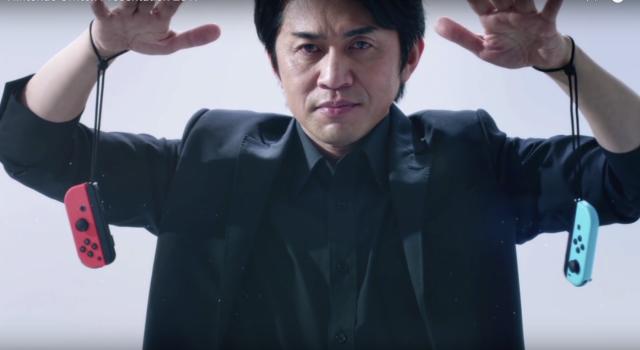 Yoshiaki Koizumi, Nintendo Switch General Producer in una posa inquietante tra il Mago Oronzo e Sub Zero di Mortal Kombat: